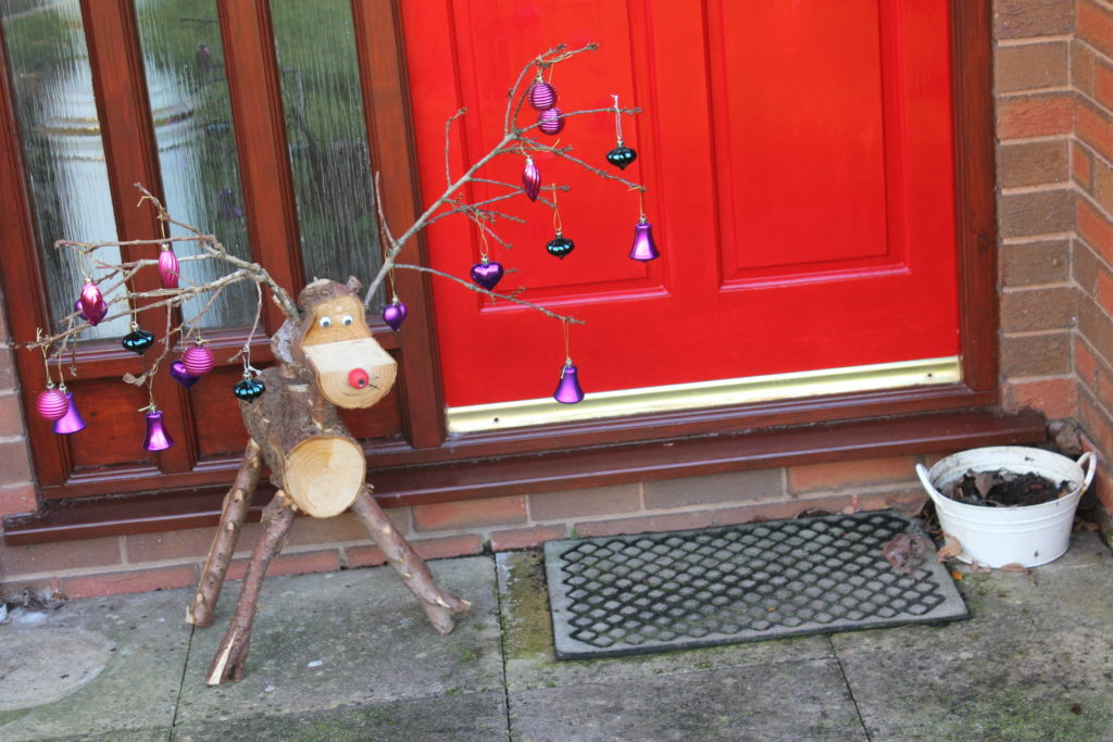 log-rudolf-with-baubles